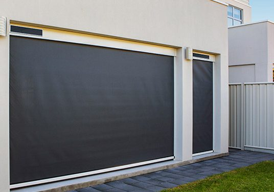 motorised-cafe-blinds-adelaide-dark-mesh-white-walls